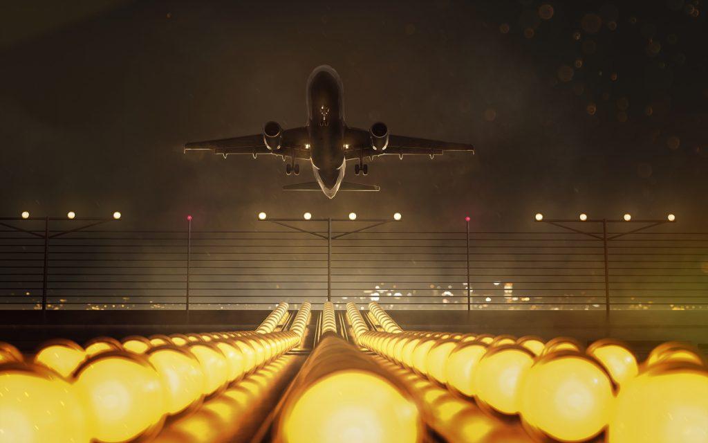 Beleuchtete Landebahn bei Nacht